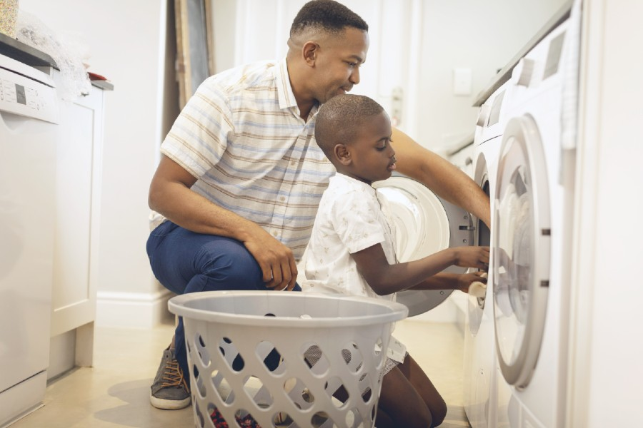 Dad and son doing laundry together