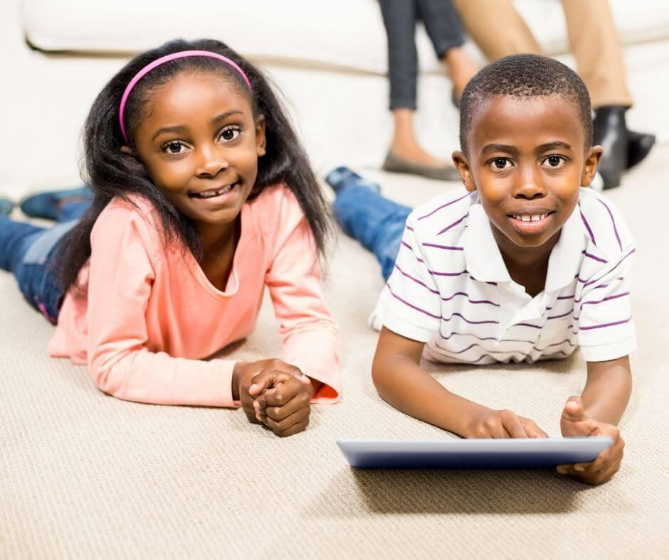 African American boy and girl playing on a tablet