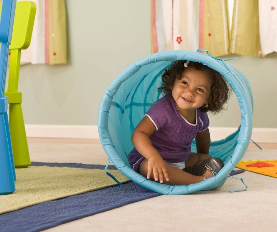girl in collapsible play tunnel
